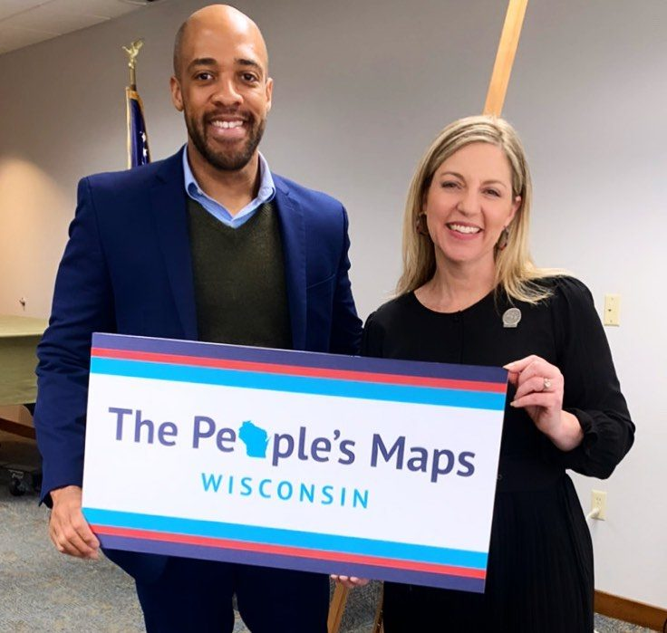 Lt. Gov. Mandela Barnes holding a People's Map sign with Robyn