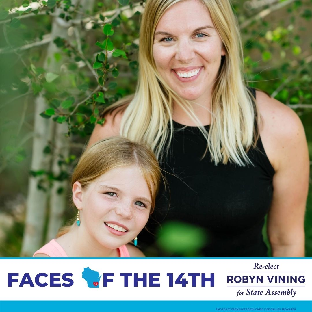 Lindsay and her daughter smiling at the camera